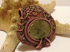 Prehnite pendant in oxidized copper. Made by Gedő Mária.