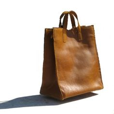 "Papr: Leather ""brown paper bag"" lined with matching lamb's wool shearling. Also available in black."