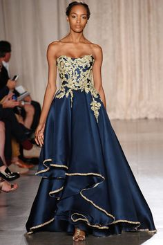 Dark blue and gold dress on catwalk needs sleeves for matron or mother