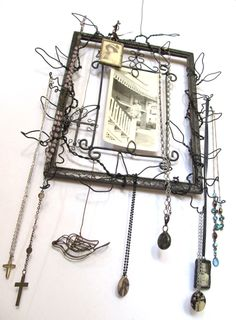 Vintage Frame and Wire Collage Jewelry Hanger with Photo Holder. $28.00, via Etsy.