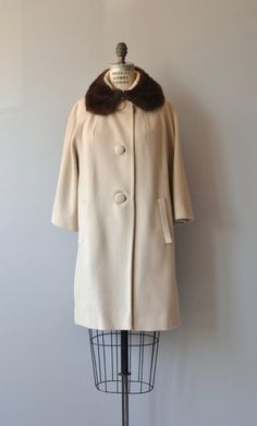 Vintage late 1950s, early 1960s Lilli Ann warm beige wool coat with round mink collar, slash pockets, large fabric buttons, A-line shape and satin