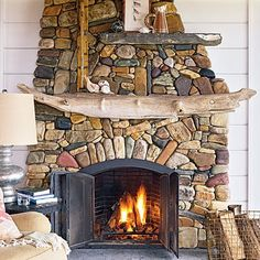 Coastal Living 2009: fireplace with river rock and beach rocks, mantel is driftwood that washed up on Esther's Beach after a storm. River Rock Fireplaces, Stacked Stone Fireplaces, Rustic Fireplaces, Wood Fireplace Mantel, Home Fireplace, Fireplace Ideas, Cottage Fireplace, Fireplace Makeovers, Fireplace Bookshelves
