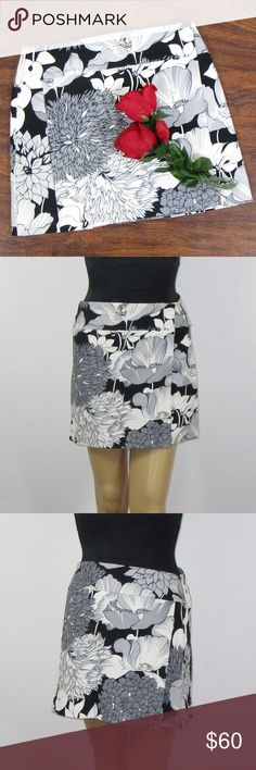 Burberry London Floral Wrap Skirt White Black Sz 4 This beautiful skirt is in excellent condition! There are a few minor darker spots on the top left corner of the skirt(See picture 7). There are a few stains on the lining as well(See picture 8). As always offers and bundles are welcome. Feel free to add one or more items to a bundle for a private discount offer!!!  Waist is 14 inches across Hips are 17.5 inches across Length is 15 inches Burberry Skirts Mini