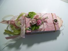 Mini album made from toilet paper rolls. Elastic closure and ribbon binding.