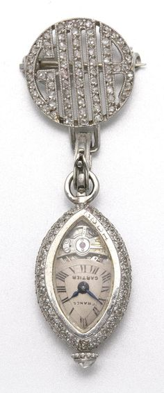 PLATINUM AND DIAMOND LAPEL WATCH, CARTIER, CIRCA 1920