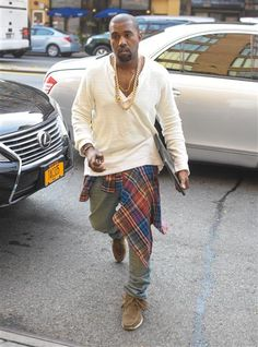 Kayne West heads to a show during Mercedes-Benz New York Fashion Week on Sept. 10, 2013.