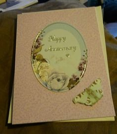 Wedding Anniversary Card. Printed card used to front base card. Foiled topped attached, peel off sentiment added, to topper. Coordinating butterfly topped added on thin sticky pads.