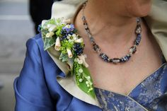 The Bride's Mum's Epaulette Corsage of fresh Lily of the Valley, Rolled Quicksand & Vendella Rose Petals, Navy Blue Viburnum Berries, Forget Me Nots, Rosemary, Ivy and Alchemilla Mollis complimented her stunning outfit beautifully