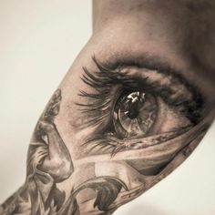 This awesome photo realistic eye tattoo is by Niki Norberg. The eye looks away from the viewer instead of making eye contact. Engel Tattoos, Tattoos Arm Mann, 3d Tattoos, Trendy Tattoos, Body Art Tattoos, Tattoo Drawings, Small Tattoos, Tattoos For Women, Tattoos For Guys