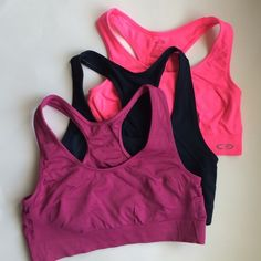 Set of 3 sports bras Good condition, pink, purple and navy Tops