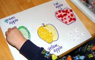 Toddlers can fill in apple shapes with colorful beads or pom-poms with this easy craft.
