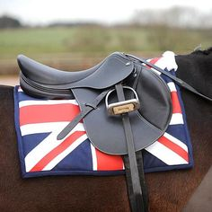 John Whitaker Union Jack Saddle Pad ONLY £39.50 @ Lofthouse Equestrian!   Show your patriotic side with this new Union Jack saddle pad from John Whitaker. This saddle pad is bright and eye-catching, making sure you stand out from the crowd.  FEATURES:  Available in red white and blue Full size only Full print Union Jack Fleece cover over the withers Navy cotton trim
