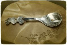 Silver sugar/christening spoon with Lemmenjoki gold nugget on viola decor. Sheltered by dwarf birch    Handmade by Tytti Bräysy  http://www.facebook.com/Metalmorfosia