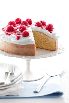 This is the only kind of cake I'll eat! Three milk cake with white creamy frosting and fresh raspberries on top! Delicious