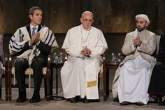 During his recent visit to the U.S., Pope Francis sits with Rabbi Elliot Cosgrove, left,...