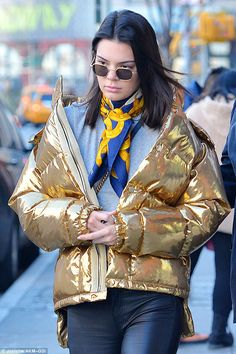 Kendall Jenner bundles up in striking gold puffer jacket #dailymail