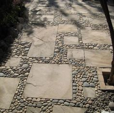 A similar take on a pebble & slate path by Oregon-based pebble mosaic designers Meta Mosaics. via inspiration green