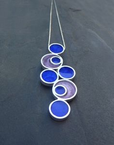 Geometric Between Circles Pendant in sterling silver and enamels by Virginia Arias