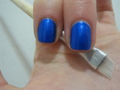 Anna Norman's tip for getting an even line of polish at the cuticle line....angled eyeliner brush dipped in nail polish remover.