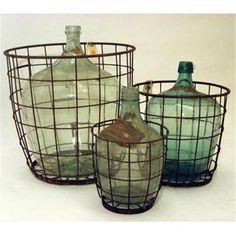 Antique wine jugs in wire baskets, early 1900's