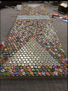 Beer pong table made out of bottle caps - http://www.theladbible.com/albums/afternoon-ladness-545/image/fcf5b0b6-b77d-11e4-a47a-d4ae52c74096