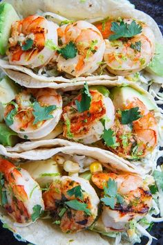 Cilantro Lime Shrimp Tacos with Roasted Corn Slaw and Roasted Jalapeno Crema Jalapeno Crema was the best. Try using sweet corn for next time and toasting with cumin or paprika. Fish Recipes, Seafood Recipes, Mexican Food Recipes, Great Recipes, Cooking Recipes, Healthy Recipes, Recipies, Think Food, I Love Food