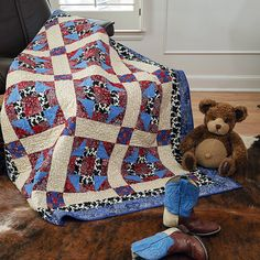 This children's quilt pattern, Giddy Up by Angie Milligan, uses fun prints for aspiring cowboys/girls. Use prints that speak to you and the kiddos in your life!