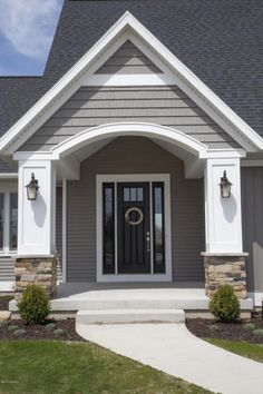 Traditional Front Door with Golden White Ledger Panel, exterior stone floors, Pathway
