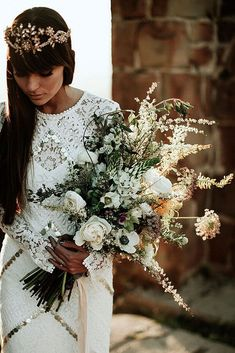 30 Bohemian Wedding Bouquets That Are Totally Chic ❤️ bohemian wedding bouquets the bride in a lace dress has white flowers with greenery bohemian bride via instagram ❤️ See more: http://www.weddingforward.com/bohemian-wedding-bouquets/ #wedding #bride #weddingbouquets #bohemianweddingbouquets