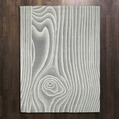 bring the outdoors in with a wood grain pattern rug