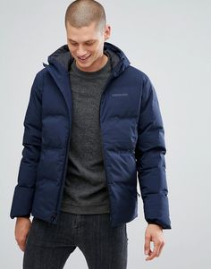 b1a784abf1d Get this Patagonia s quilted jacket now! Click for more details. Worldwide  shipping. Patagonia Jackson Glacier Hooded Down Jacket in Navy - Navy   Jacket by ...