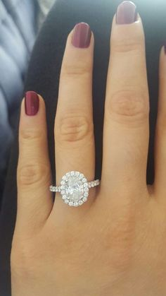 Oval halo engagement ring from Barron's Fine Jewelry