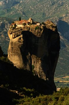 Monastery of the Holy Trinity - Meteora, Greece.  Go to www.YourTravelVideos.com or just click on photo for home videos and much more on sites like this.