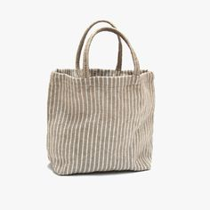Stylish, durable and 100% earth friendly, our White Stripe Jute Shopper Tote has been handwoven by women working within a Fair Trade program.