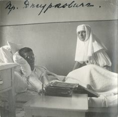 Olga with a wounded soldier during WWI