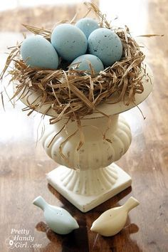 small raffia filled flower urn with blue eggs and a sweet s&p bird set