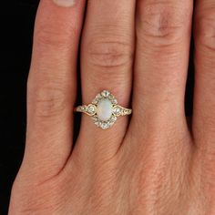 Art Nouveau Opal, Diamond, and Gold Halo Ring | From a unique collection of vintage engagement rings at http://www.1stdibs.com/jewelry/rings/engagement-rings/