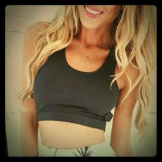 Black crop top with cut outs racer back Brand new black crop top with cut outs and a racerback brand new got a Boutique Tops Crop Tops