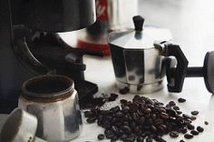 An espresso jug and coffee beans Coffee Beans, Espresso, Food Photography, Coffee Maker, Bakery, Cooking Recipes, Editorial, Espresso Coffee, Coffee Maker Machine