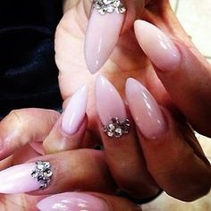 Light pink stilleto gel nails with gems, this looks so cute