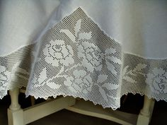 Vintage linen tablecloth with fillet crochet edging of rose motif.