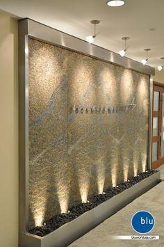 spa reception desk - Good option for stone logo wall, if didn't want to do water Schönheitssalon Design, Flur Design, Lobby Design, Wall Design, Clinic Interior Design, Spa Interior, Clinic Design, Spa Reception Area, Reception Desk Design