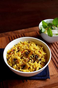mushroom biryani recipe made easy with step by step photos. this is a delicious south indian style mushroom biryani recipe and also known as kalan biryani. this spicy south indian mushroom biryani pairs very well with onion-tomato raita.