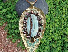 Gemstone Pod Pendant Instructor: Kat Clark Workshop Fee:  $35 Sunday, April 24 (2-5pm) Learn to shape silver, copper or brass sheet into a lovely pod shaped form. Texture and emboss to your heart's content. A gorgeous flat gemstone bead takes center stage, pretty side-drilled pearls or beads and crystals for embellishment. Scale is key. Bonus instructions using Gilder's paste will be covered. Metal fabrication skills helpful but not required. Materials list.