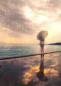 Beach rain photography rain storm beach girl nature umbrella