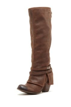 """Fergie  Latitude High Rise High Heel Boot  Impressive antiqued leather wraps a strap-slung boot fashioned with a weathered toe to give a standout look that is captivating.  - Round weathered toe  - Side zip closure  - Strap details at the collar and ankle  - Cuffed detail at the heel  - Approx. 2.5"""" heel height  - Approx. 15"""" shaft height, 14"""" opening circumference  $180.00"""