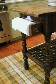 Paper towel holder made from an old vintage sewing machine drawer