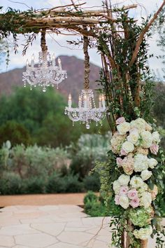 chandeliers deocrated rustic outdoor wedding arch