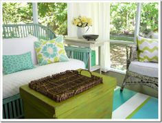 A screened porch, decorated with garage sale and thrift store finds!