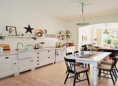 Cream Country Kitchen with Barn Star and Industrial-style Pendant Lights